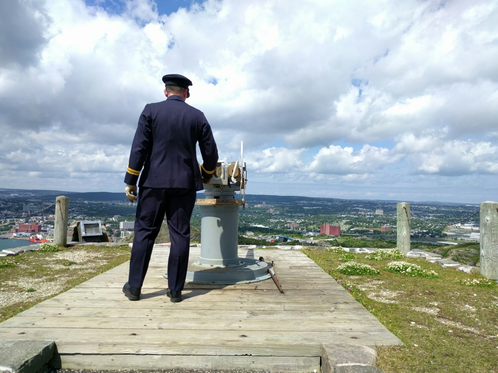 Naval officer fires the noonday gun over St. John's